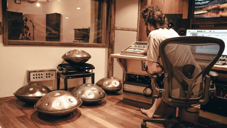 a man sitting in a recording studio